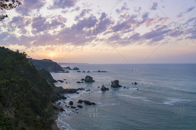Spain, north coast, Asturias, coastline, rocks, Playa del Silencio from above, sunset