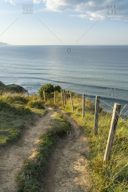 Spain, north coast, Basque Country, flysch route, hiking trail, fence
