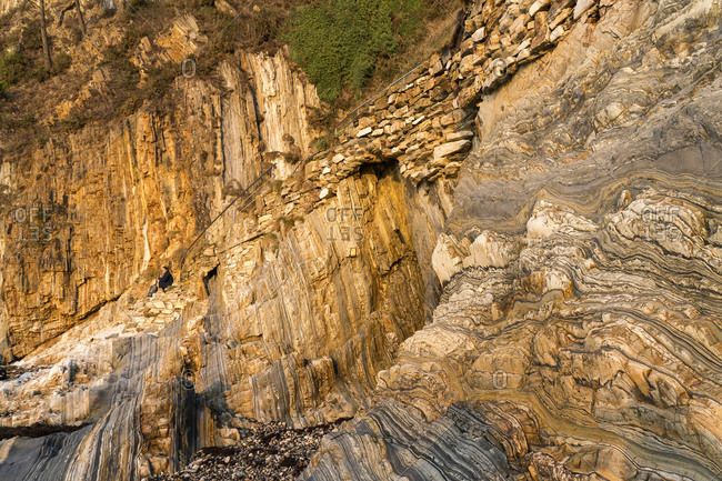 Spain, north coast, Asturias, coast, rocks, Playa del Silencio, seated woman, rest