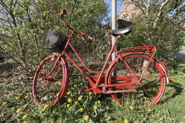 Germany, Lower Saxony, East Frisia, Emden, old bicycle as a decoration.