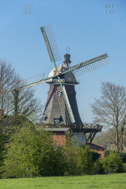 Germany, Lower Saxony, East Frisia, Emden, Larrelt, the Larrelter Muhle (Kost Winning) a two-story Dutch windmill.