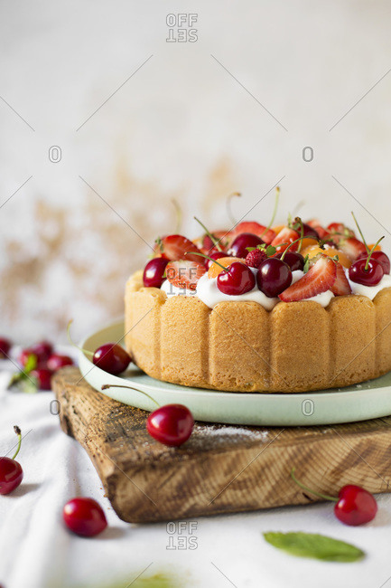 Cake with summer fresh fruit on the table. Close up