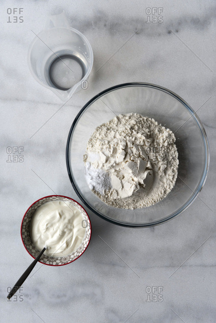Soda bread ingredients on a marble background