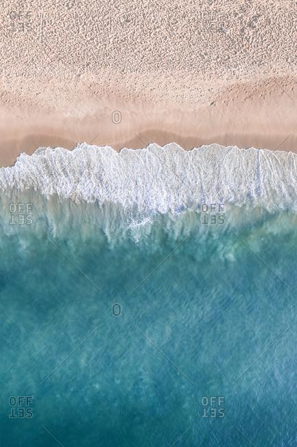 Aerial View Of Tropical Ocean Waves Breaking On Empty Copacabana Beach, Rio De Janeiro, Brazil
