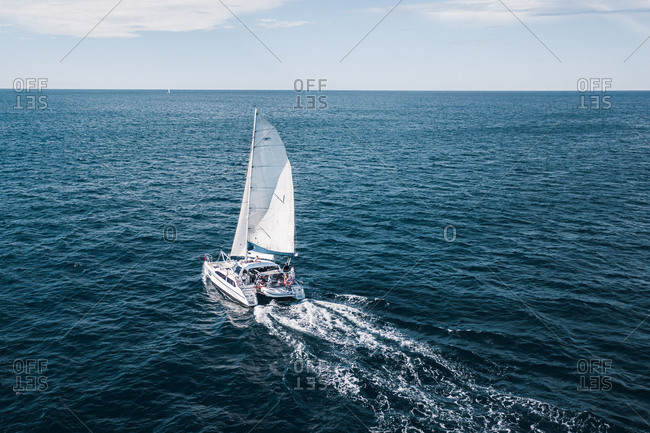 June 10, 2019: Aerial View Of Catamaran Sail Boat Sailing Out Into Open Pacific Ocean Off The Coast Of Sydney, Australia