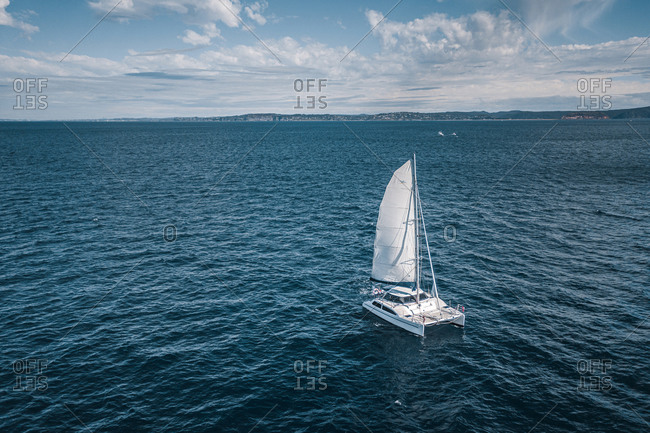 June 10, 2019: Aerial View Of Catamaran Sail Boat Sailing In The Pacific Ocean Along The Coastline Of Sydney Australia