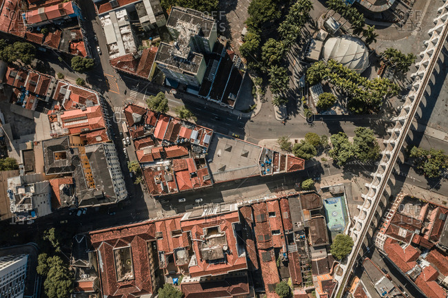 Aerial Top Down View Of The Lapa Aqueduct Arches And Historical Buildings Surrounded By Tropical Palm Trees In Rio De Janeiro, Brazil