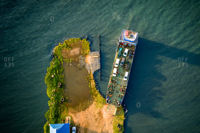 Aerial view of a ferry docking at Lwanda K'otieno pier, Lake Victoria, Kenya. The ferry carries cars and passengers between the Lwanda K'otieno and Mvita Piers.