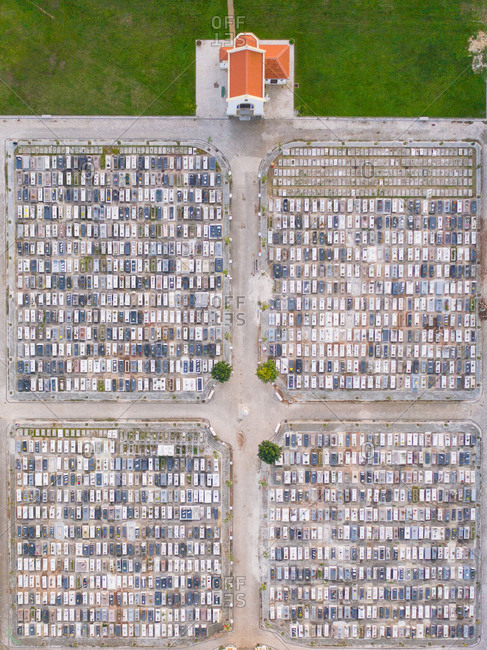 Aerial view of the patterns of the graves and the chapel of a cemetery in Aveiro, Portugal
