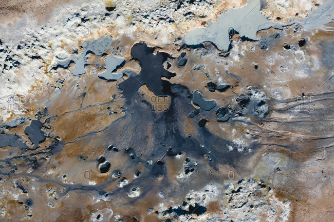 Aerial view of abstract patterns created by hotsprings and mudpots, in Hverir geothermal area in North Iceland.