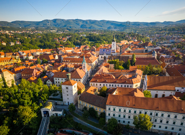 Aerial view of the city with mountains in the background on sunny day in Zagreb, Croatia