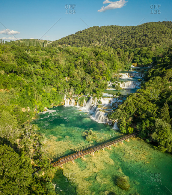 Aerial view of Skradinski Buk waterfall surrounded by trees in Lozovac, Croatia
