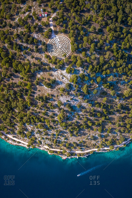 Aerial view of shoreline surrounded by turquoise water in Rogoznica, Croatia
