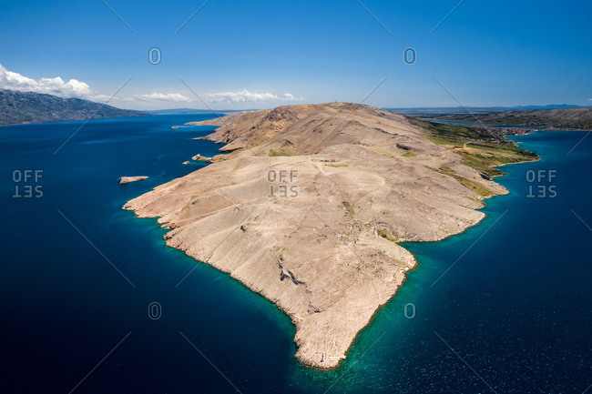 Aerial view of the shoreline surrounded by turquoise water in Opcina Pag, Croatia