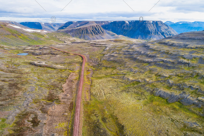 Aerial view of the unpaved road 624 between mountains, mountain pass Sandsheidi, Westfjords, Iceland