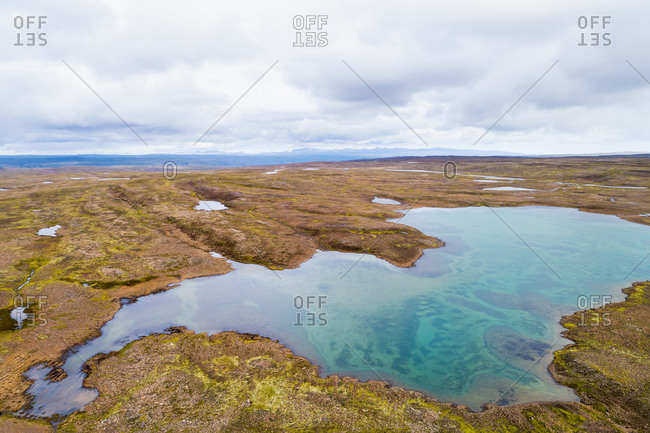 Aerial view of a shallow lake on a mountain plateau, Kollabudaheidi, Westfjords, Iceland