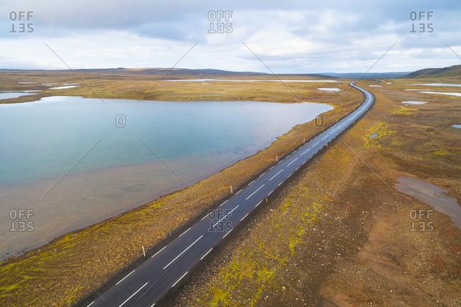Aerial view of ring road 2 through the Westfjords, from Holmavik to Isafjordur, passing lakes on mountain plateau Steingrimsfjardarheidi, Iceland