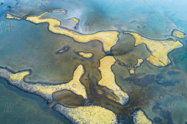 Abstract aerial view of small amazing islands shaped like curious animals in a shallow inlet of the sea, Hvammsfjordur, Sneafellsnes, Iceland