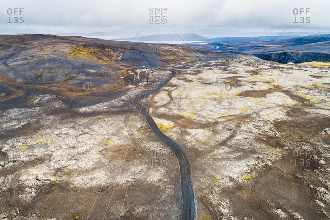 Aerial view of the 4WD road F208 from Landmannalaugar to Sprengisandur with power line in desolate landscape, highlands of Iceland