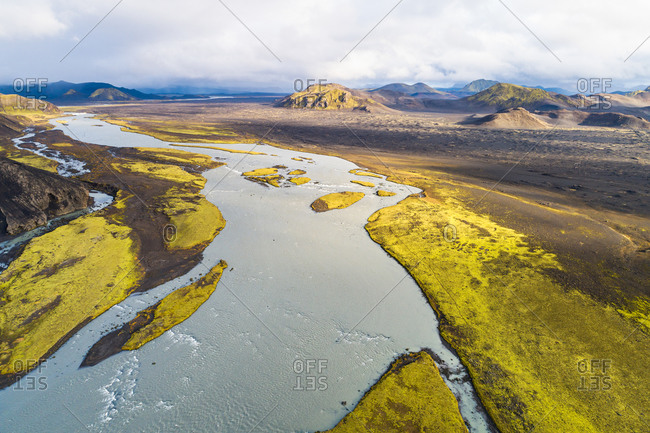 Aerial view of river Tungnaa  between the mountains in beautiful sunlight, Fjallabak nature reserve, highlands of Iceland
