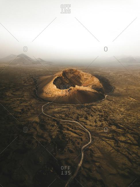 Aerial view of El Cuervo volcano in a dusty morning, Lanzarote, Canary Islands, Spain
