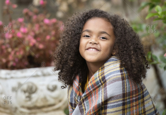 Portrait confident girl in plaid shawl