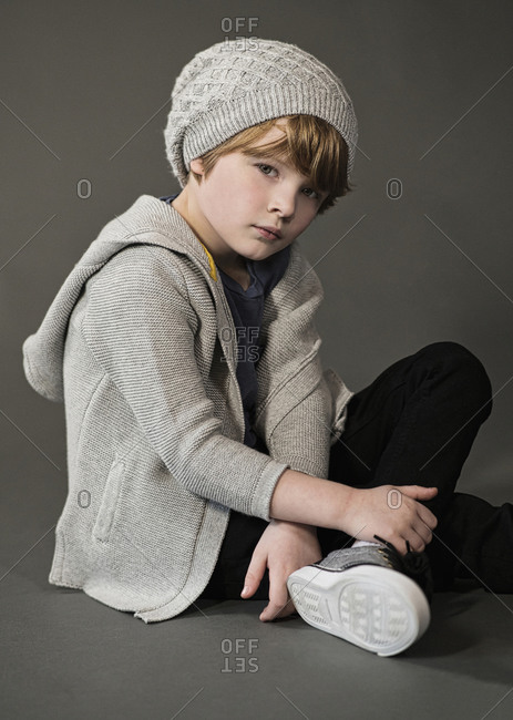 Portrait confident, cool boy in knit hat and sweater