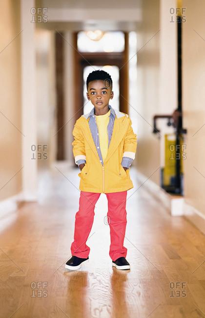 Portrait confident, cool boy in vibrant jacket and pants