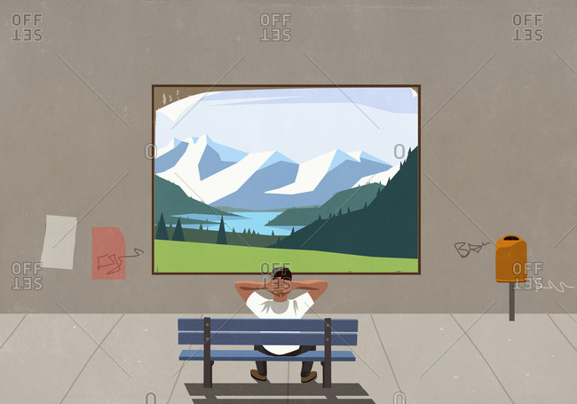 Man on bench watching landscape on urban billboard