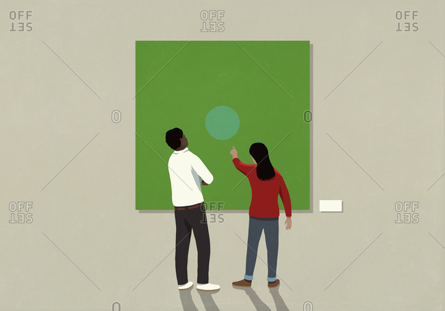 Couple looking at abstract art in museum