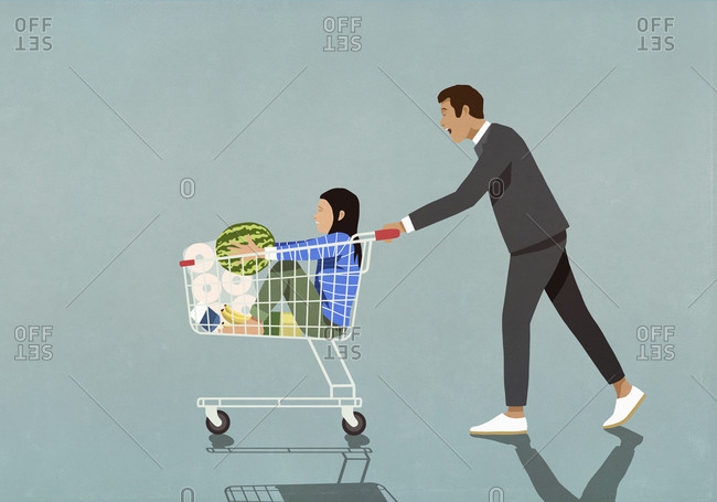 Father pushing daughter and groceries in shopping cart