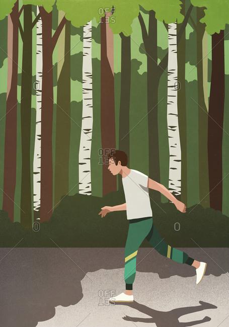 Man jogging in sunny park