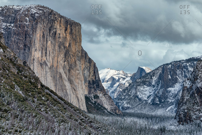 Yosemite Valley view in winter with El Capitan and Half Dome after a snow storm.