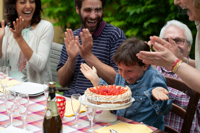 Boy being surprised with birthday cake