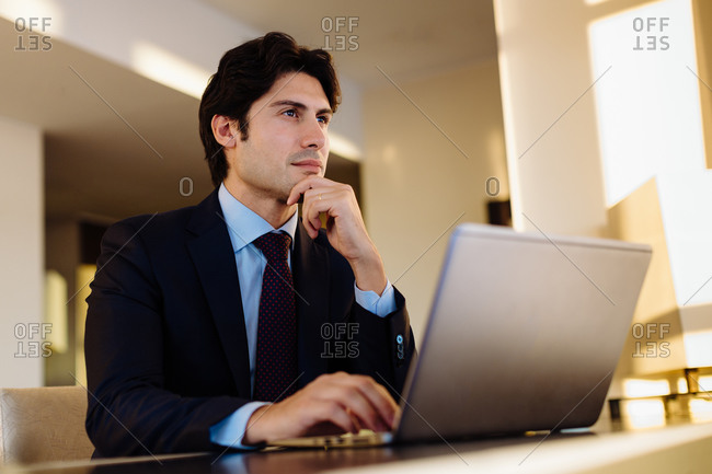 Businessman working in business center in hotel