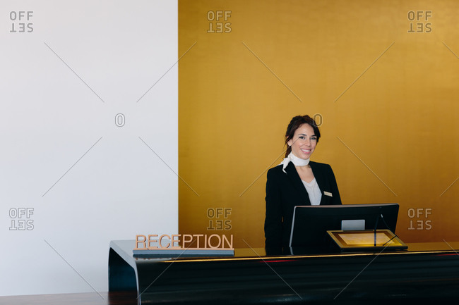 Hotel receptionist working in the lobby