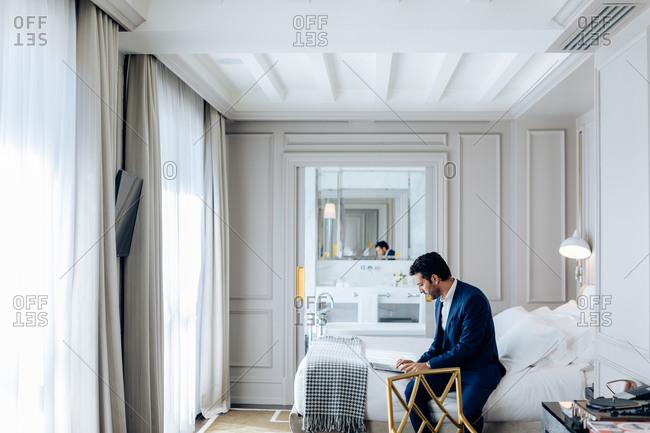 Businessman using laptop in suite