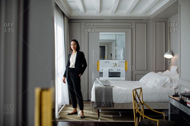 Businesswoman beside window in suite