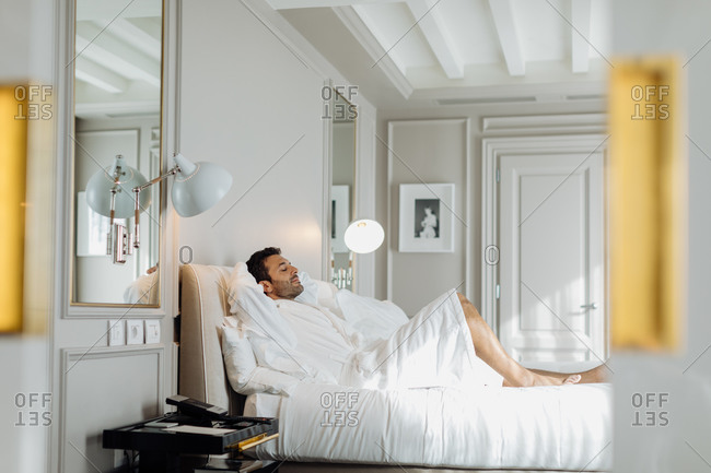Man relaxing in hotel suite