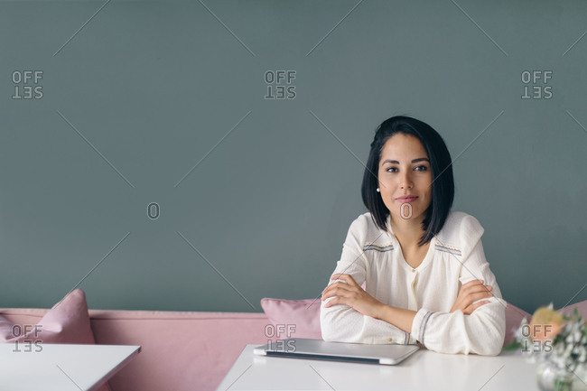 Young businesswoman at hotel table, portrait