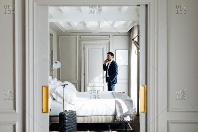 Businessman using smartphone in suite