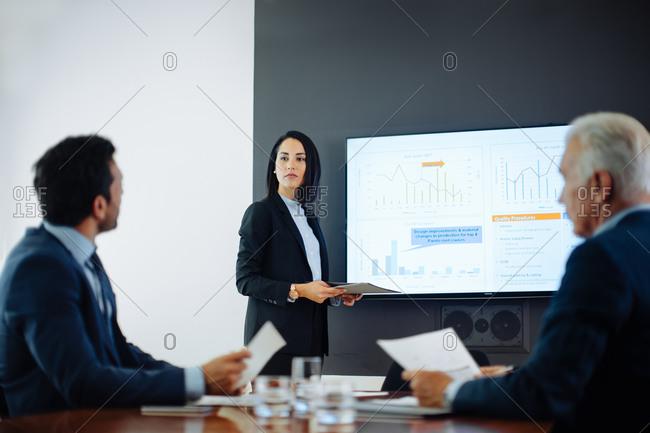 Two businessmen meeting at boardroom presentation