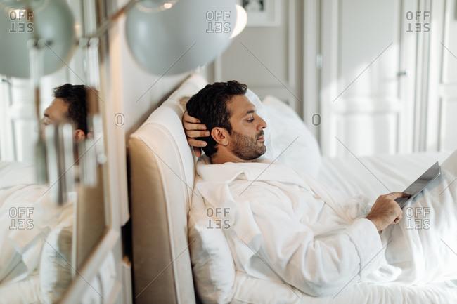 Man using digital tablet in suite