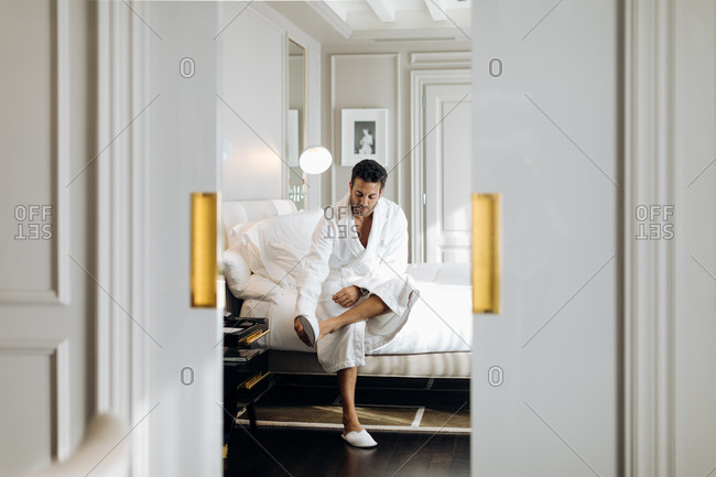 Man wearing bedroom slipper in suite