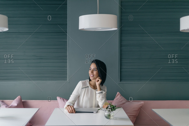 Young businesswoman at hotel table looking away