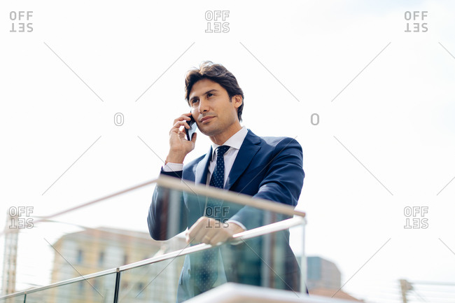 Businessman using smartphone on terrace