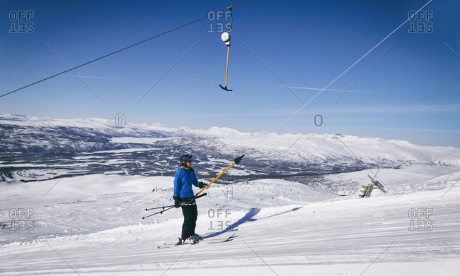 Man on a ski-lift in Vasterbottens Lan, Sweden.