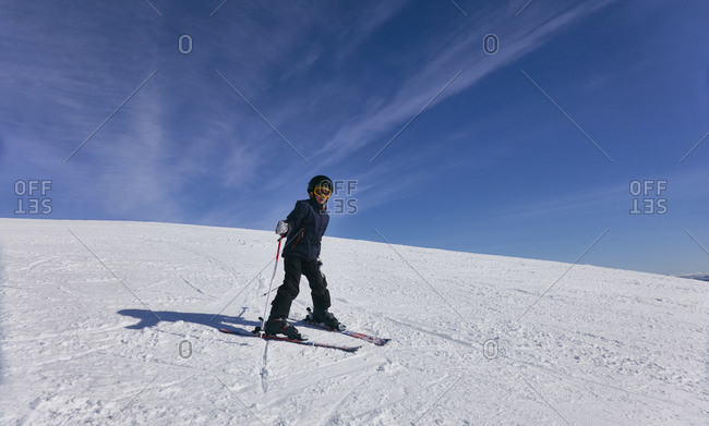 Young boy cross-country skiing in Vasterbottens Lan, Sweden.