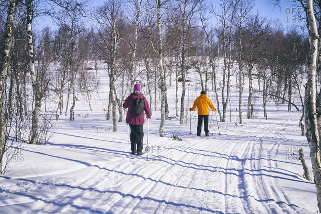 Couple cross-country skiing in Vasterbottens Lan, Sweden.