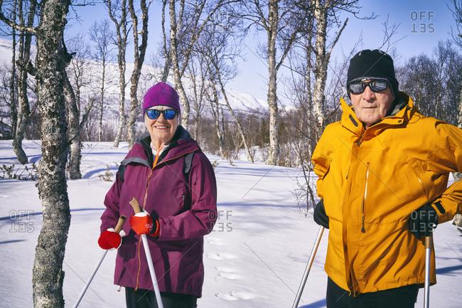 Couple cross-country skiing in Vasterbottens Lan, Sweden.